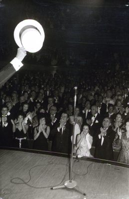 00067 Maurice Chevalier holding arm hat to audience GOOD