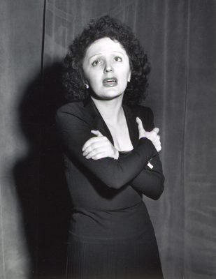 Edith Piaf arms crossed